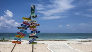 beach on the riviera maya with direction sign