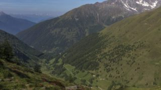 green carpeted mountains in the valley of Ponte di Legno in Brescia province Italy