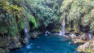 waterfalls around a lake