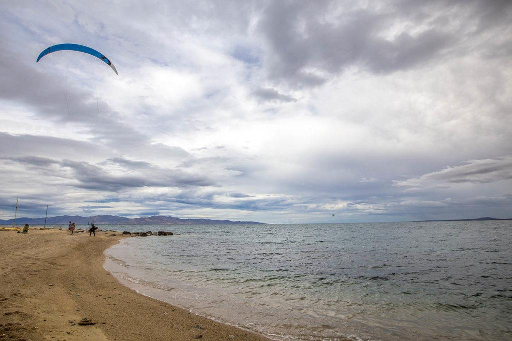 kite surf flying on a bay cloudy sky
