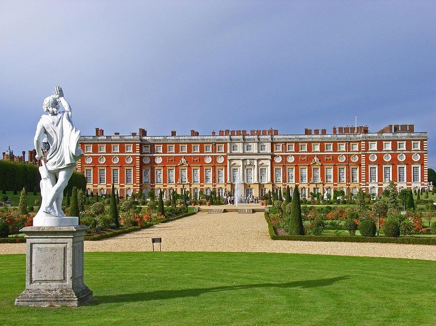 Hampton court red brick palace a statue and a huge garden