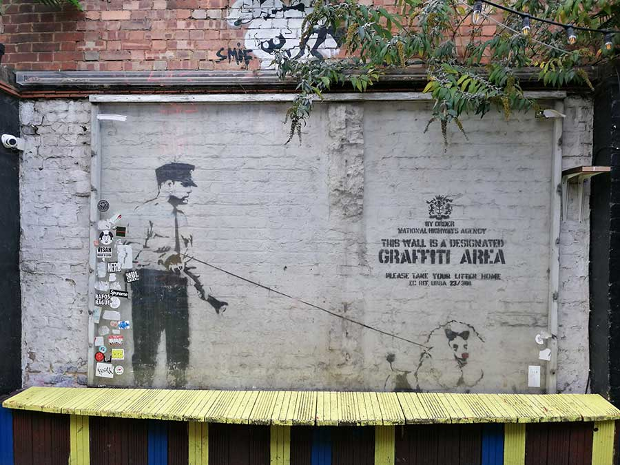 Banksy art - policeman with pet on a leash