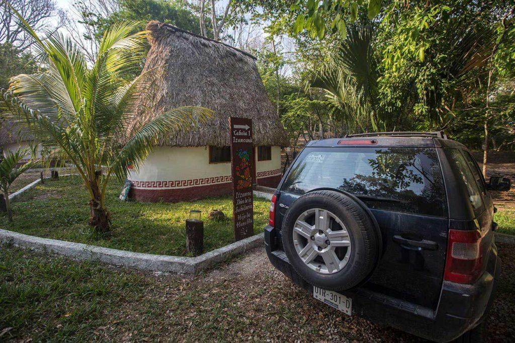 Car in front of a bungalow
