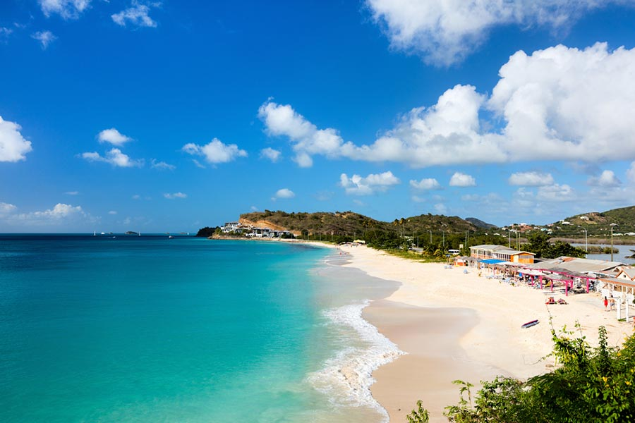 white sand beach and turquoise sea in antigua