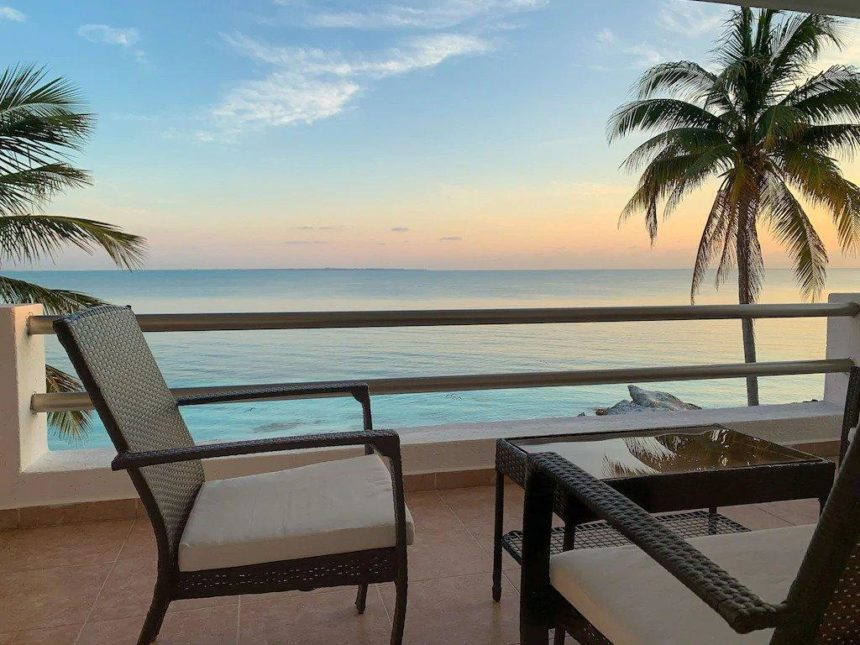ocean villa balcony with sunset view