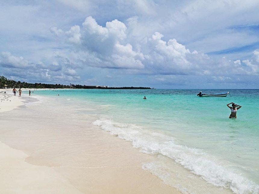 xpu-ha beach with people in the water