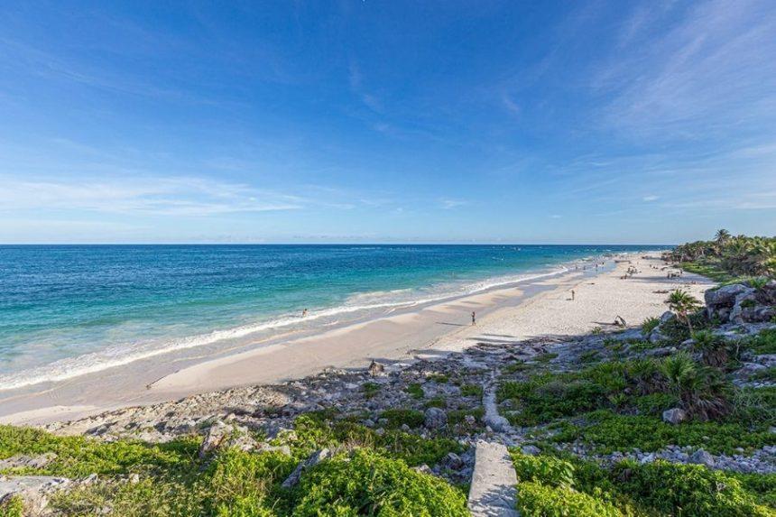 tulum beach on a sunny day and blue sky