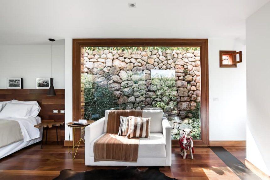 Cusco airbnb - stylish tiny home - sofa and stonewall