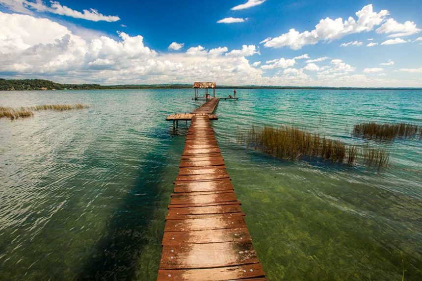 green lake with a board walk