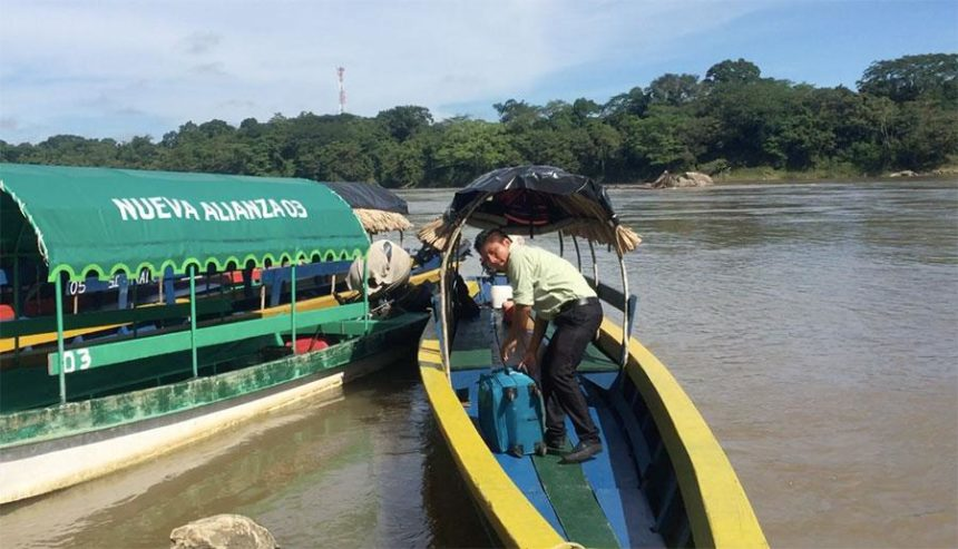 BOATS TO YAXCHILAN on a river
