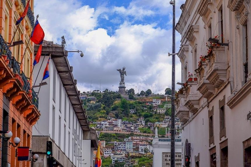 quito buildings with a statue on a hill at the back