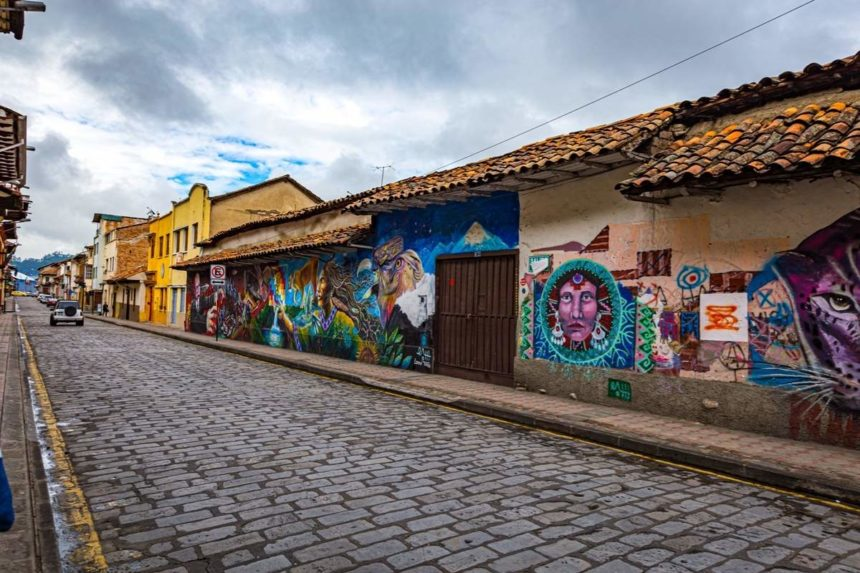 cuenca street lined with murals