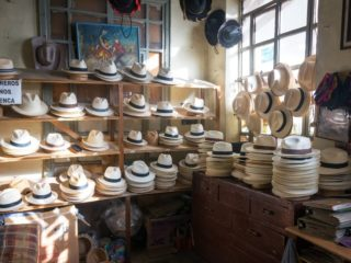 hats on shelves by a wall