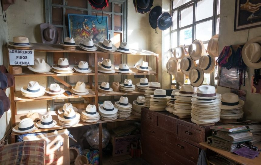 hats on shelves by a wall- origin of Panama hat