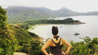 woman looking at a bay