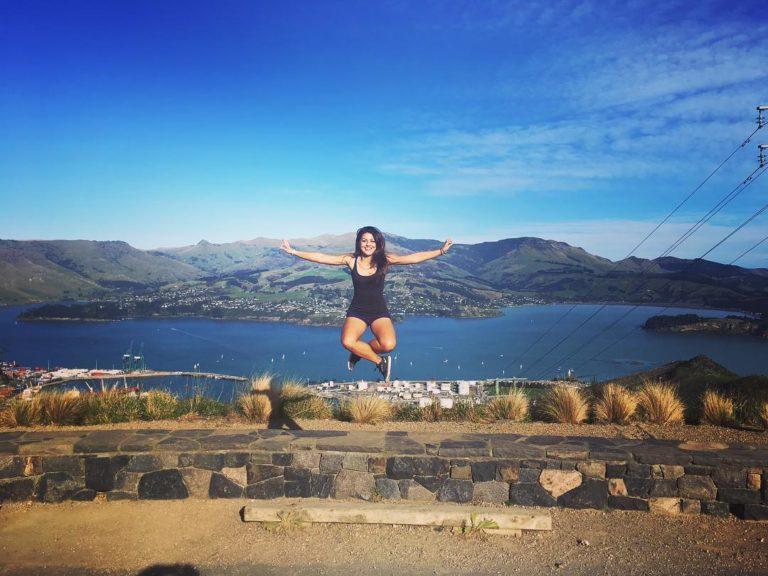 girl jumping cross legged