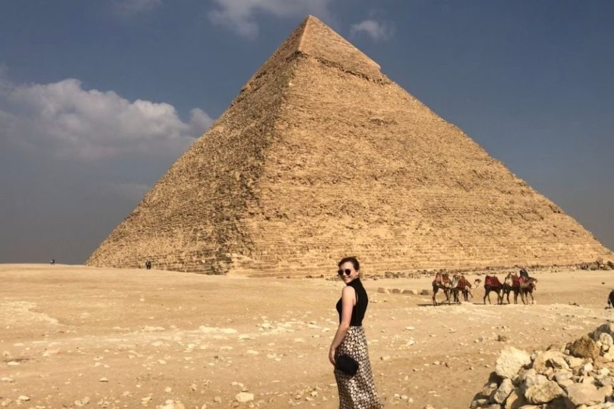 girl with a pyramid in the background