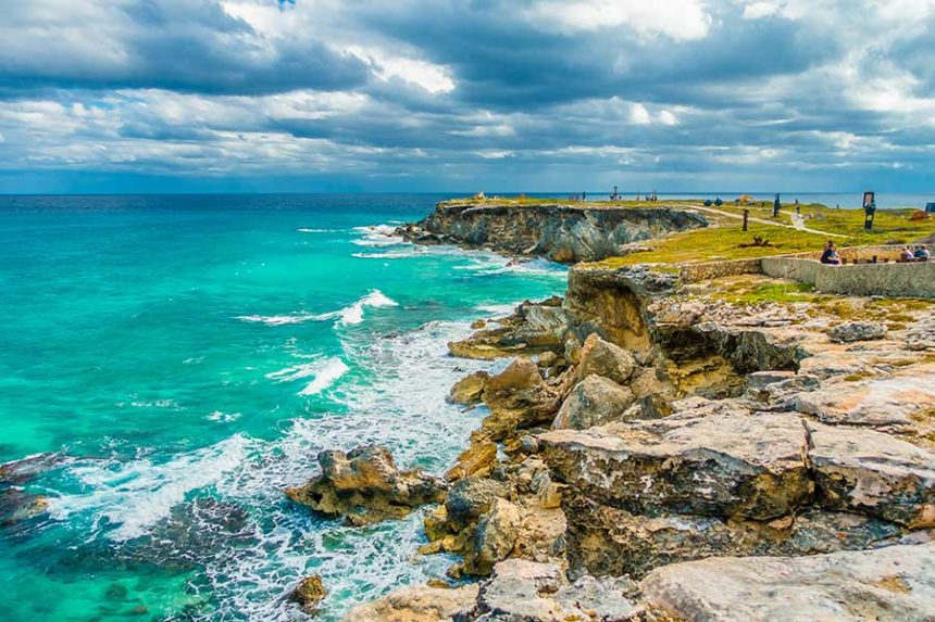 rugged coast with green and blue water
