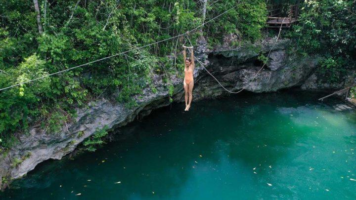 girl on a zipline over a lake