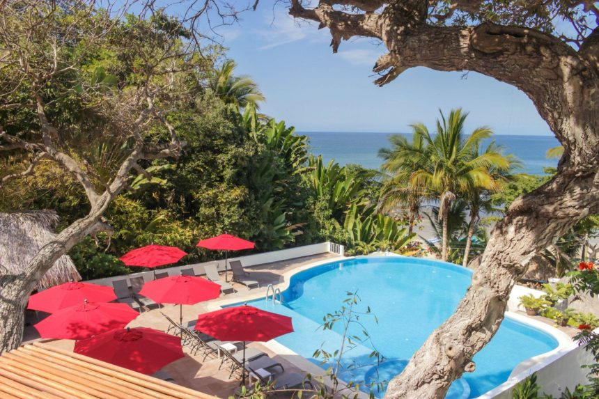 pool with red sunshades