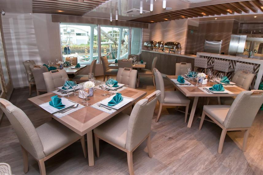 indoor restaurant of a luxury boat in the Galapagos