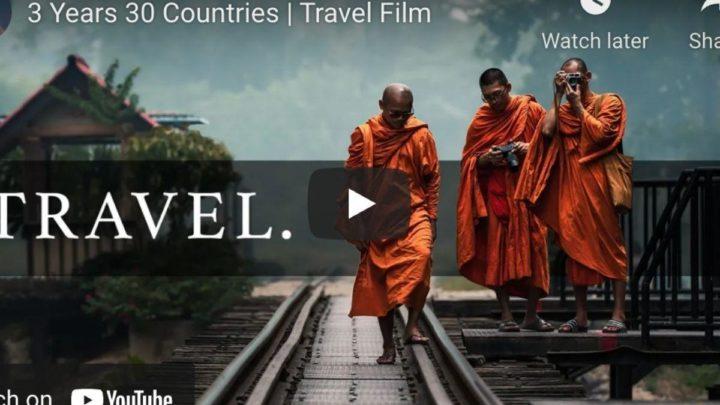 three monks walking on a rail road