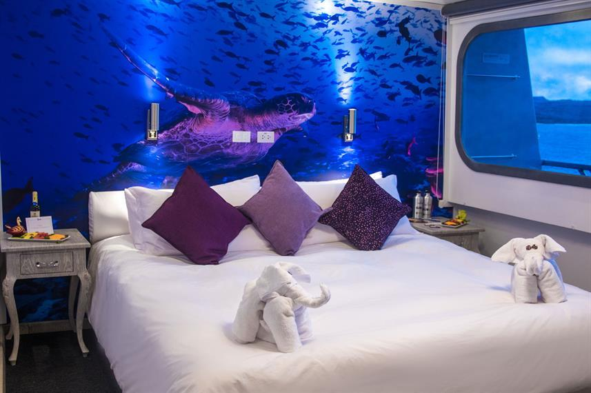 Camila cruise cabin with a picture of a shark occupying the entire wall behind the bed