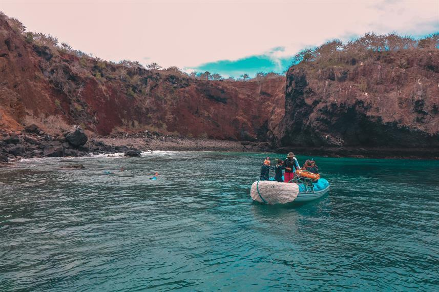 on a panga boat in a bay at the galapagos