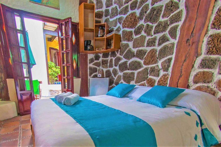 casa del lago hotel bed with stone wall