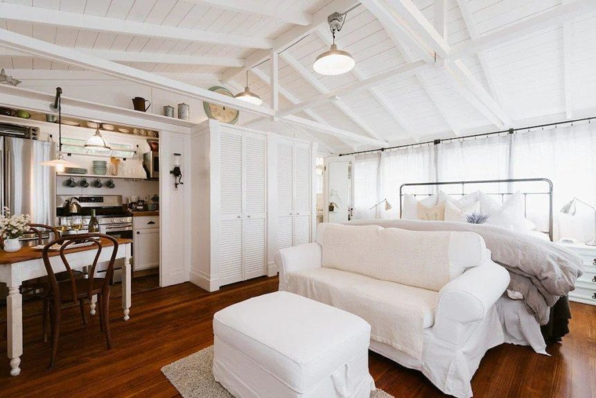white studio with bed and kitchen