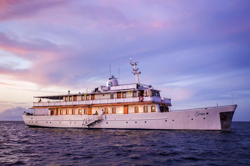 grace boat galapagos at sunset