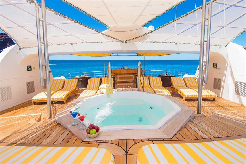 hot tub on top of a deck of a cruise ship