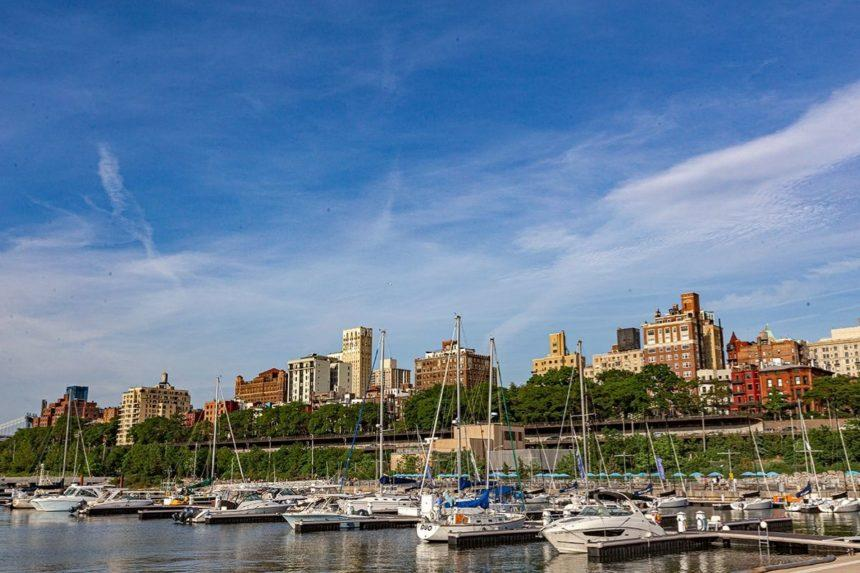 fancy buldings lined with boats on the East River New York