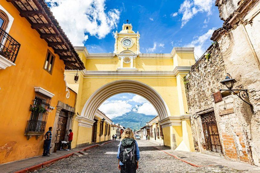 ME STANDING BELOW THE ARCH IN ANTIGUA GUATEMALA