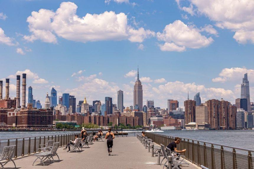 manhattan skyline  girl runnning on a pier