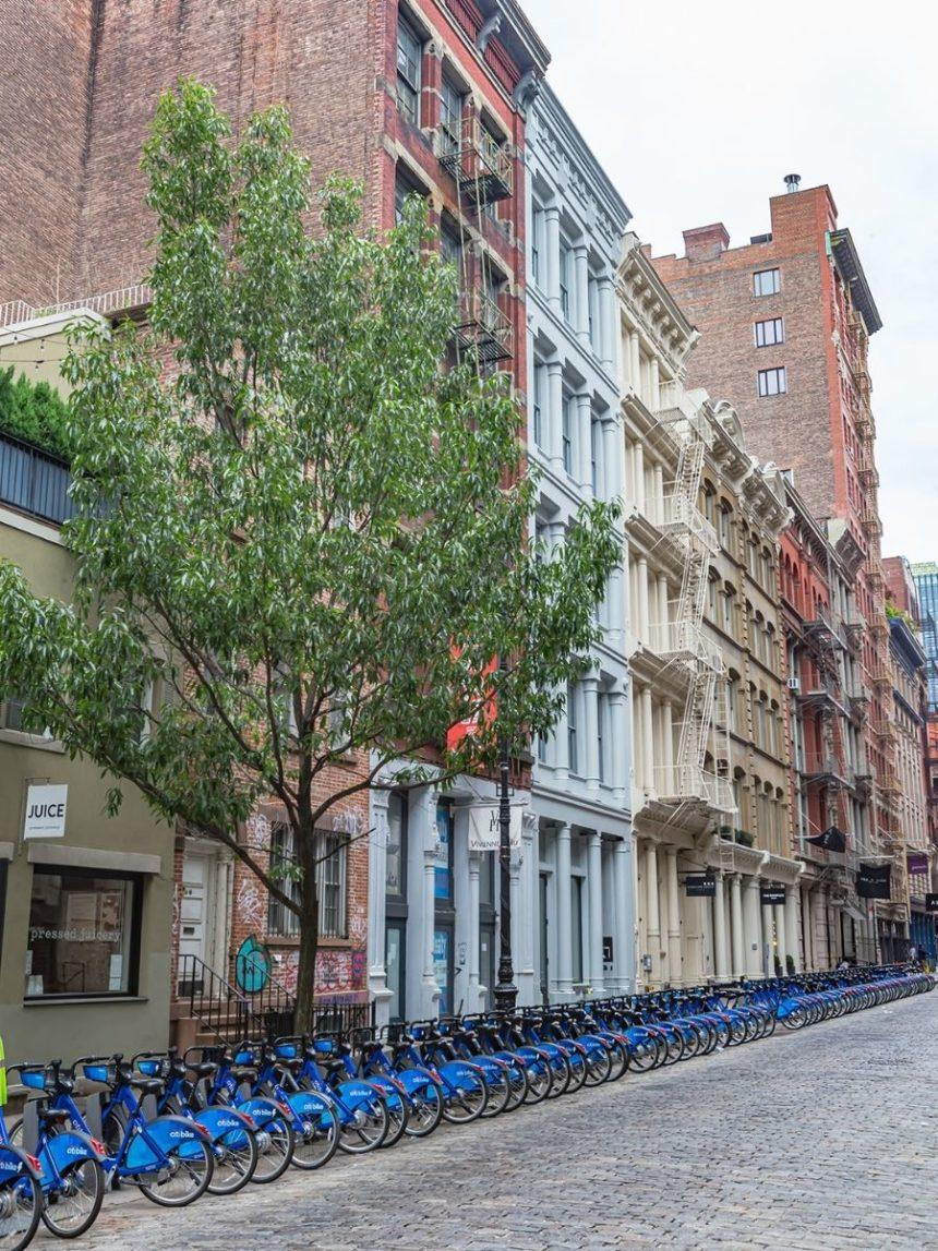 bycicles lined by buildings