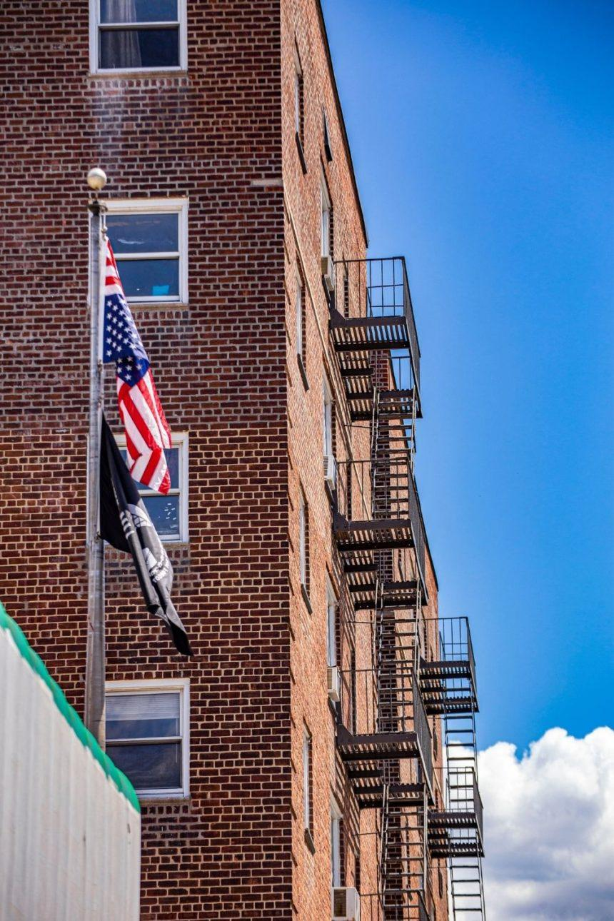 red bricks building and an american flag