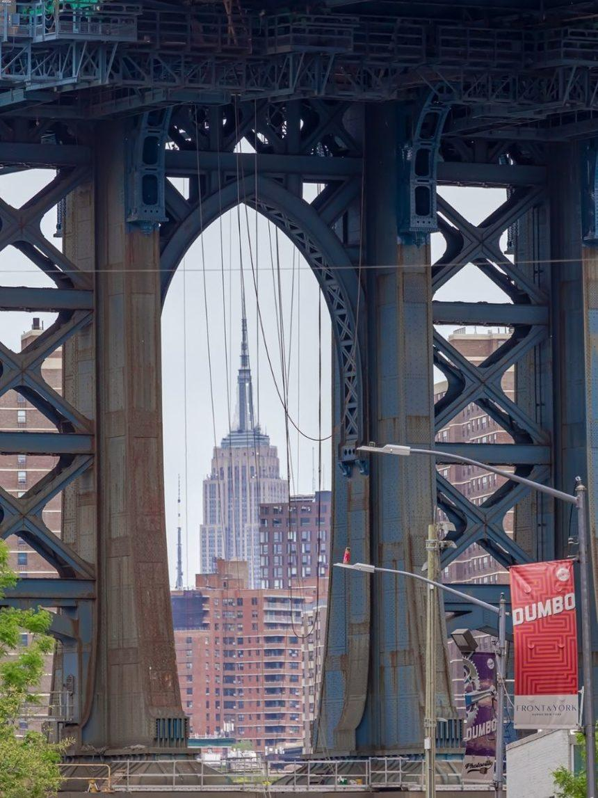 manhattan bridge close up with empire state building in the middle