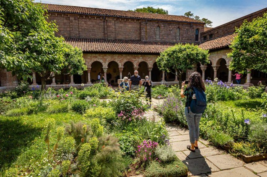 Girl taking a picture in the cloisters