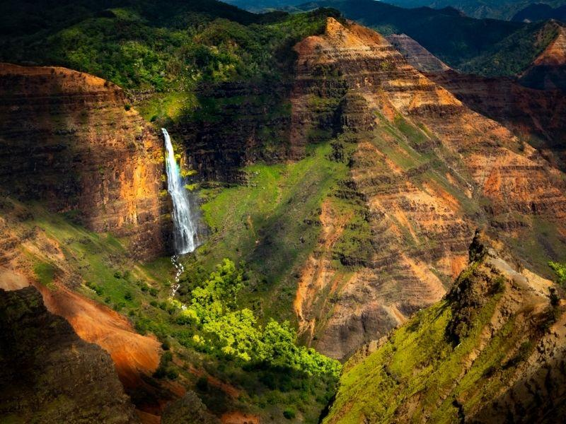 waterfalls surrounded by mountains