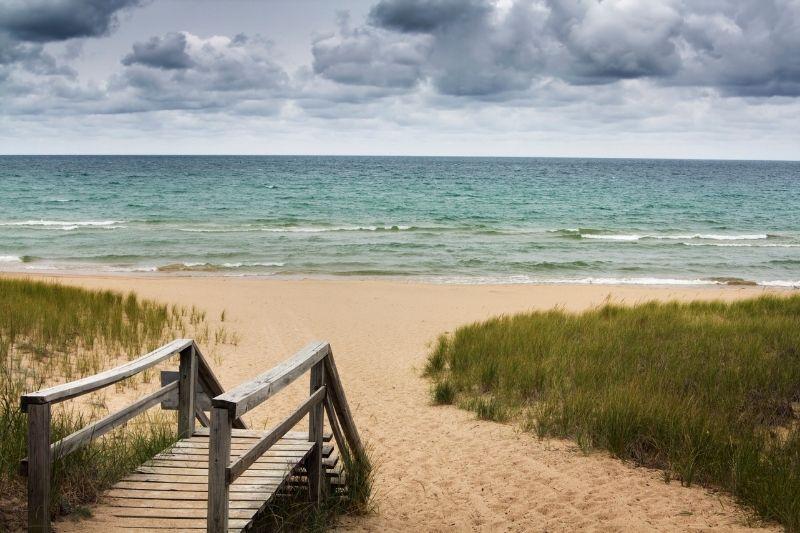 board walk to a beach on a lake
