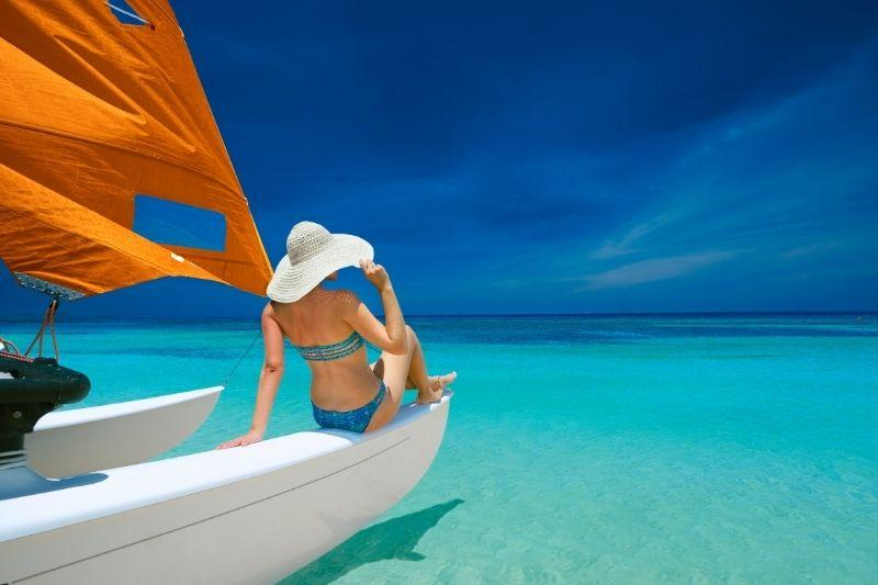 woman on a boat on a blue sea