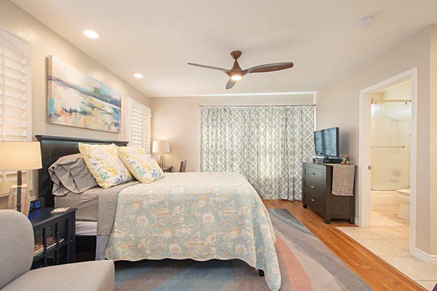 HB studio- bed and bathroom corner