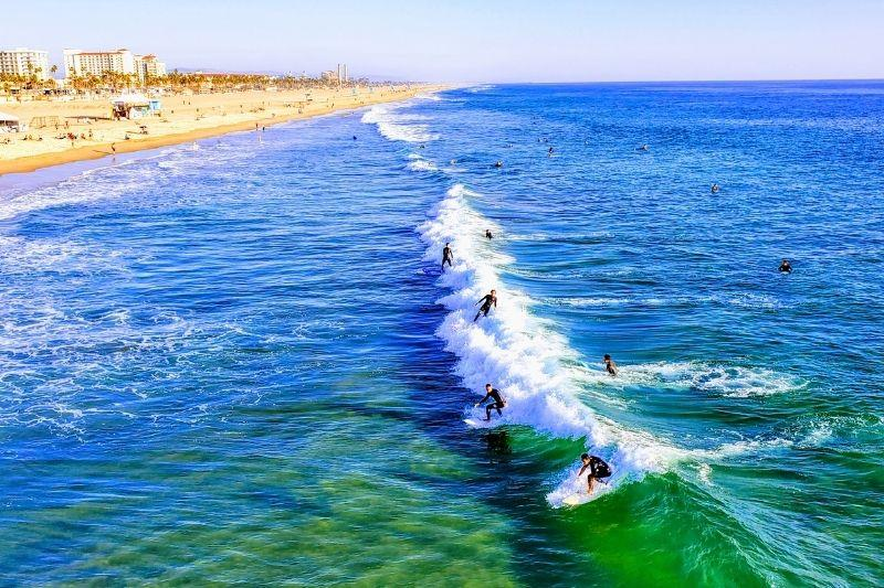 Surfer on catching waves in Huntington Beach