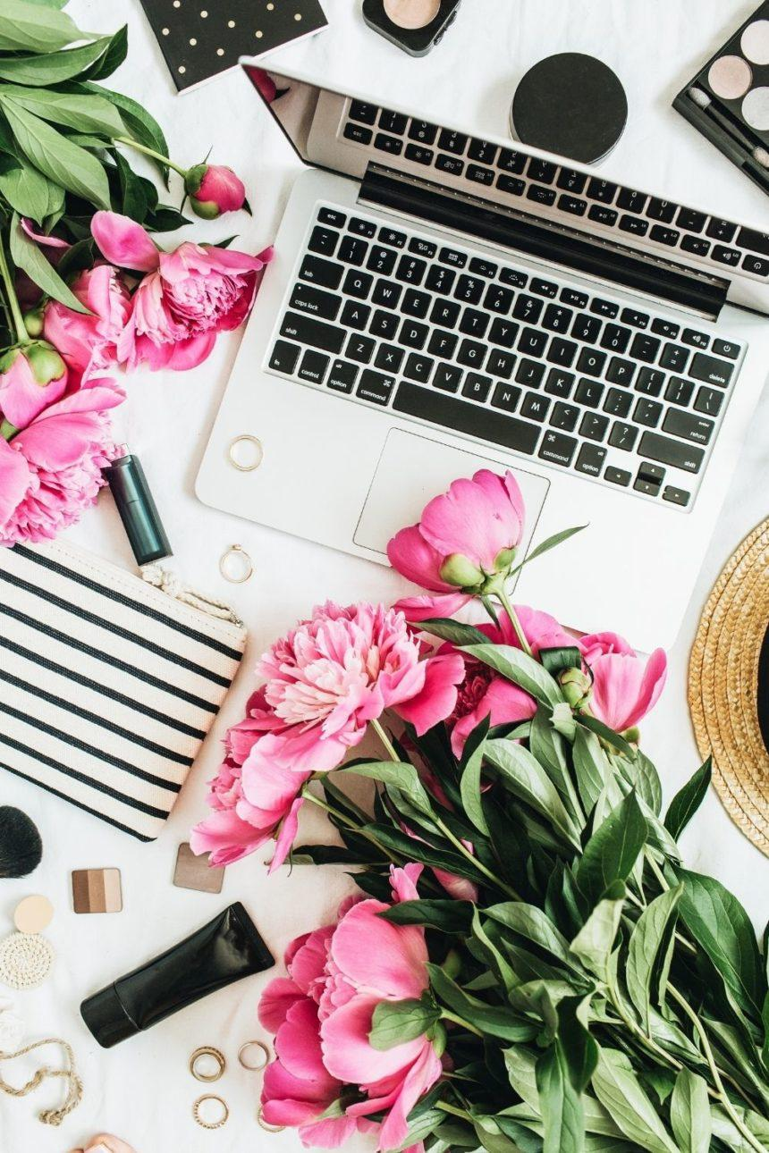 laptop surrounded by flowers
