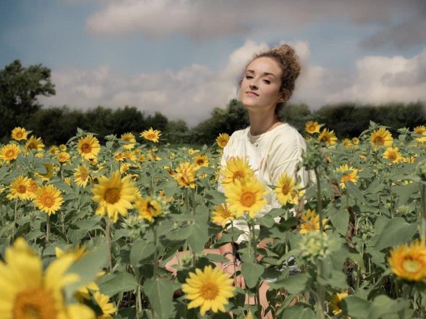 Robinson family farm - model in a sunflower field